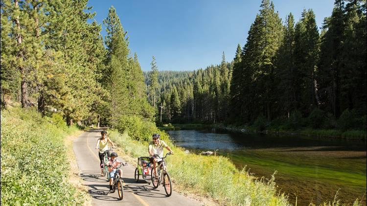 Family biking along Truckee River